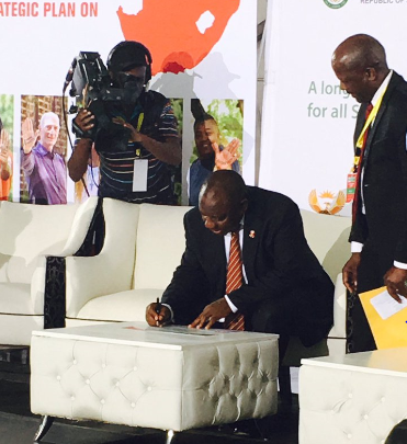 The Deputy President signing the NSP pledge